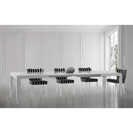 Dalì extendable or fixed table in wood with multiple finishes and an unmistakable style