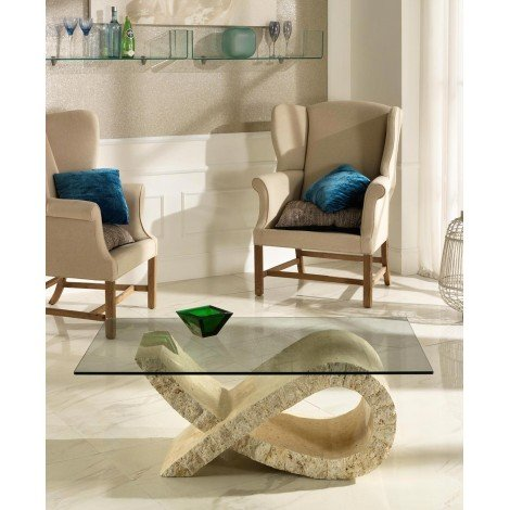Fiocco smoking table of the Stones line with base in fossil stone and glass top. Suitable for hotels, apartments and studios