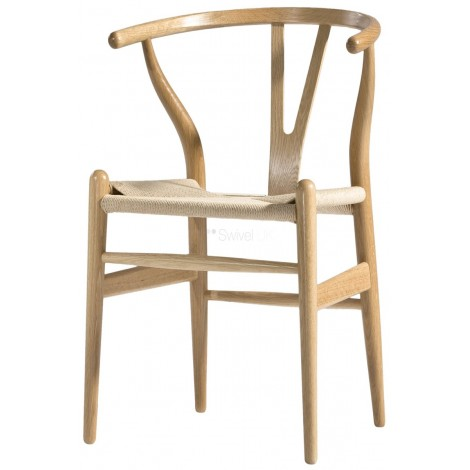 Re-edition of the Wishbon armchair by Hans J Wegner in birch wood