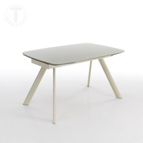 Charlotte extendable table by Tomasucci with metal structure and glass top. Internal extensions to the structure