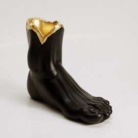Foot vase in hand-worked resin, entirely produced in Italy available in glossy black with gold interior