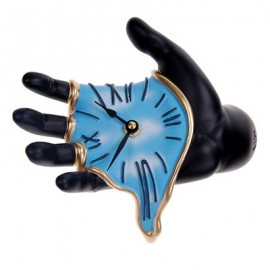 Mano Muro wall clock measures cm D 20 x H 9 x L 19. Hand-decorated resin.